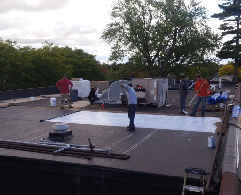 Rubber roof installation in progress